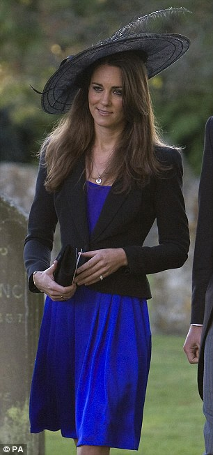Glamorous: The Duchess of Cambridge wore the black hat, which she hired, to a friend's wedding in 2012