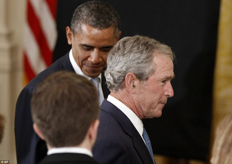 Watch your back: President Obama and President Bush are said to have a cordial but not close relationship