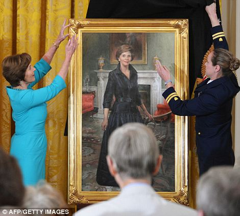 Outfit selection: Though she opted for a bright dress for the ceremony, Mrs Bush chose an elegant black gown for her formal portrait which will be permanently hung in the White House