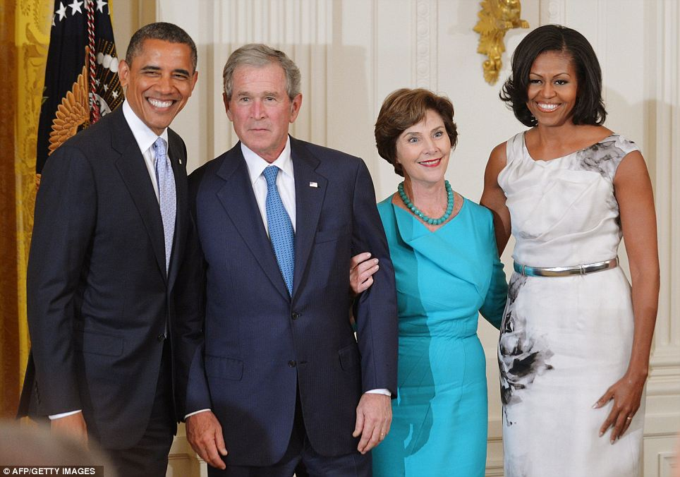 Happy faces: Presidents Barack Obama and George W. Bush were joined by their respective first ladies Michelle and Laura