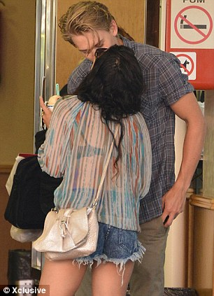 Couple canoodling: Vanessa and Austin smooch on a bench and then outside a store in the Spanish city