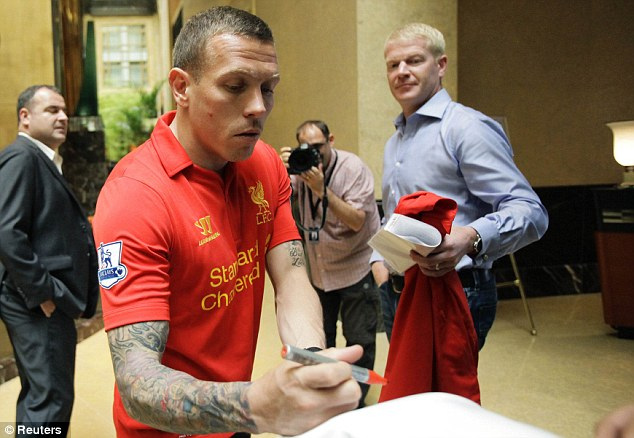 New kit: Craig Bellamy shows off Liverpool's new strip