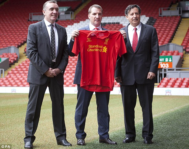 Big hitters: Rodgers with Liverpool's managing director Ian Ayre (left) and chairman Tom Werner (right)
