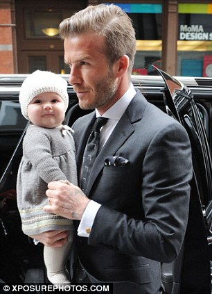 Baby love: David with his daughter Harper earlier this year