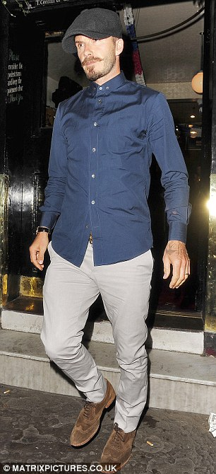 You can take the boy out of the East End... David Beckham leaves The Cow gastropub in West London last night