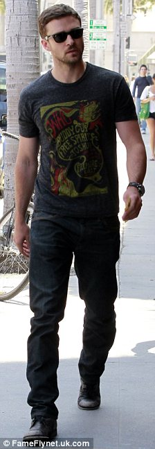 That's better: Justin was quickly back to his standard wardrobe of T-shirt and jeans
