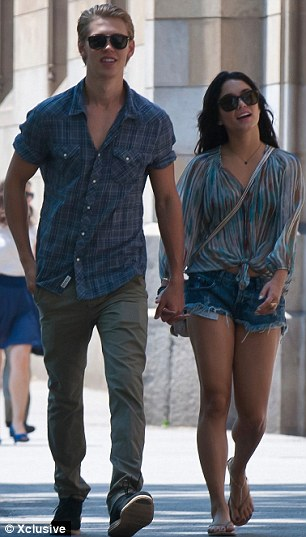 Casual chic: Vanessa showed off her long slim legs in a pair of denim cut off shorts