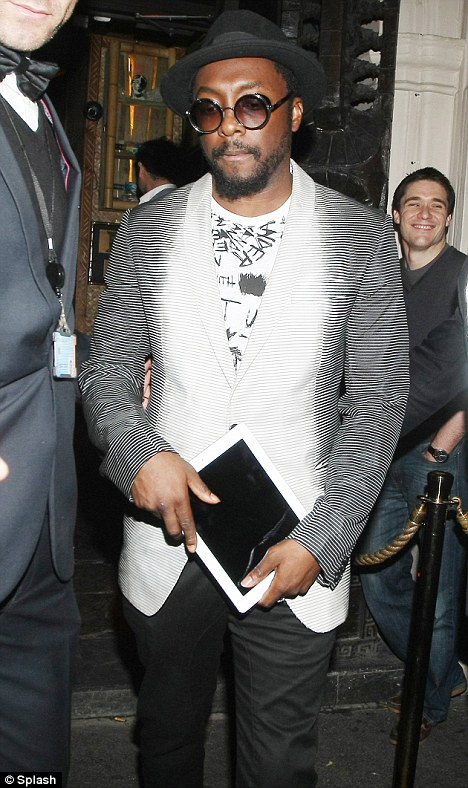 Why so serious? Will.i.am left the club separately to Cheryl and looked rather glum as he did so