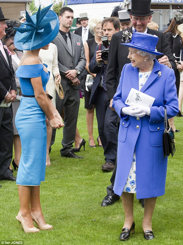 We're clashing! Katherine's dress was a rather different blue to that of the Queen's