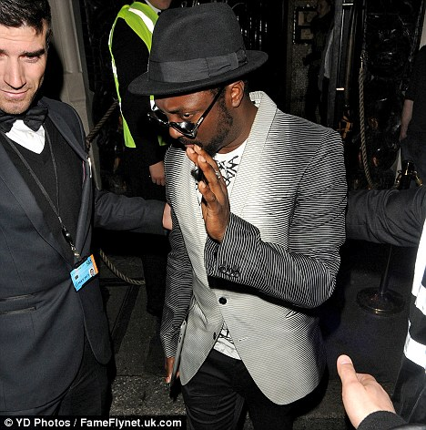 Don't touch me! Will.i.am tries to leave the club without getting his photo taken...