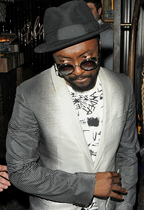 Did you wear those glasses inside the club? Will.i.am sports his usual dark shades