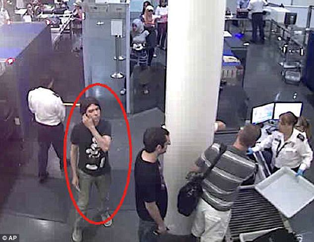 CCTV: Interpol issued this undated photo of Magnotta passing through an unnamed airport security checkpoint