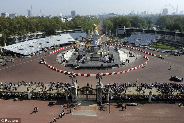 Stage is set: The Queen Victoria Memorial is prepared for the Diamond Jubilee concert, which forecasters say will take place under clear skies