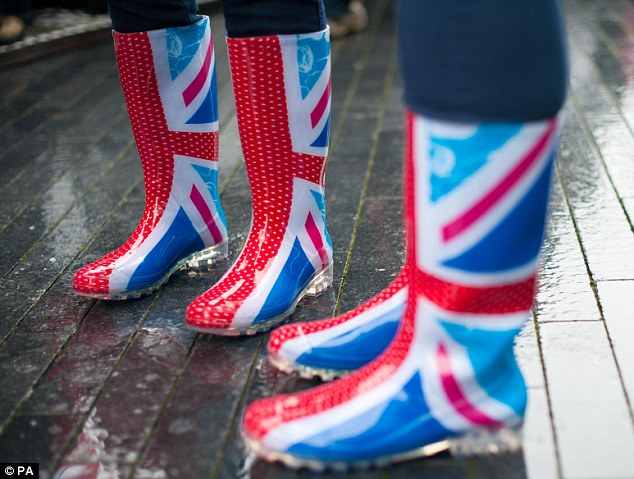Dressed for the occasion: These wellington boots proved a practical and patriotic choice for pageant spectators near London's Tower Bridge