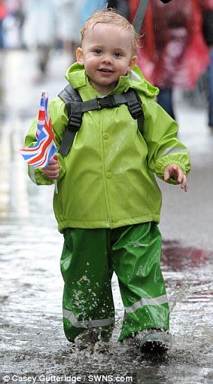 Splashing time: William Nelson Smith, aged nine months, enjoys the party