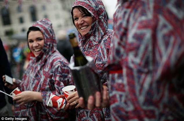 Downpour chic: Waterproof ponchos were the must-have garment at yesterday's Thames pageant, but luckily there's a brighter outlook for tonight's concert