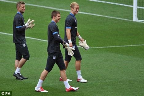 Team-mates: Butland (centre) could join England No 1 Joe Hart at Manchester City