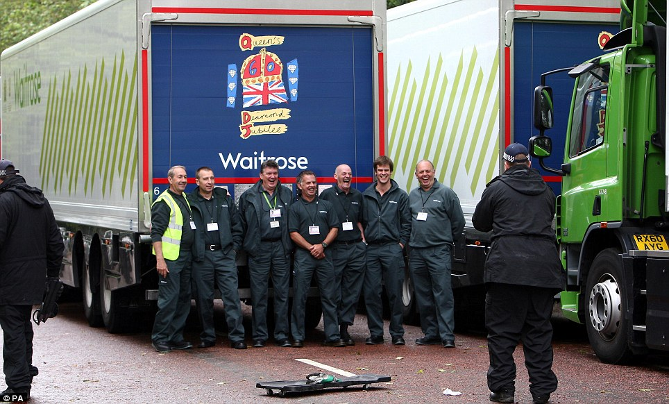 Drivers pose for a picture as their Waitrose lorries containing the 10,000 picnics for today's Diamond Jubilee Picnic are searched on Constitution Hill