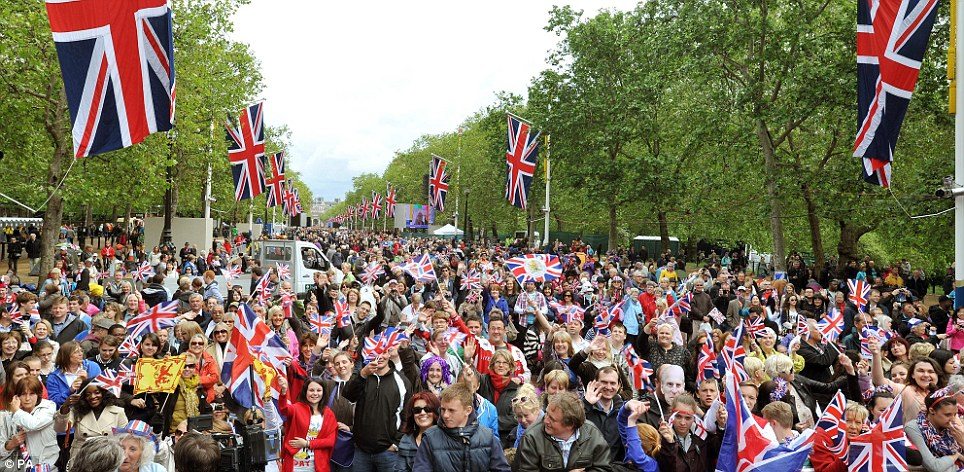 Large crowds gather in the Mall as they wait for the start of the concert featuring Sir Paul McCartney, JLS and Sir Elton John