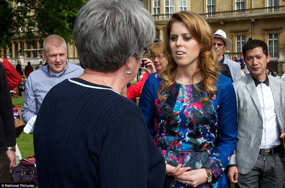 Friendly: Princess Beatrice talks to one lady as she enjoys the picnic