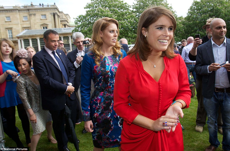 Welcoming: Princess Eugenie, front, and Princess Beatrice, back, greet the crowds in Buckingham Palace