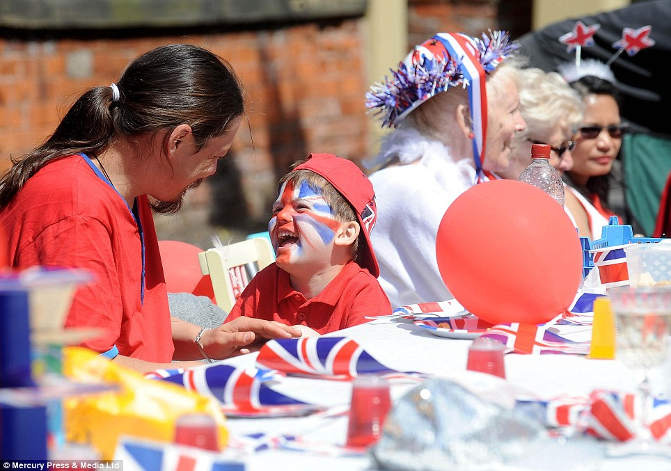 Just for laughs: A youngster enjoys the pomp and circumstance of the big celebrations during the Crosby Road street party in Southport