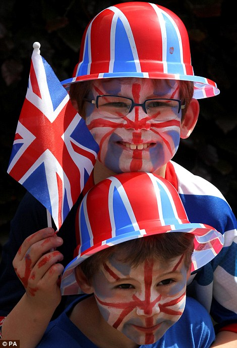 Hats on for the Queen! Seven-year-old Ben (top) and five-year-old Harry Nussey of Murrayfield Drive in Edinburgh go Union Jack crazy at their street party