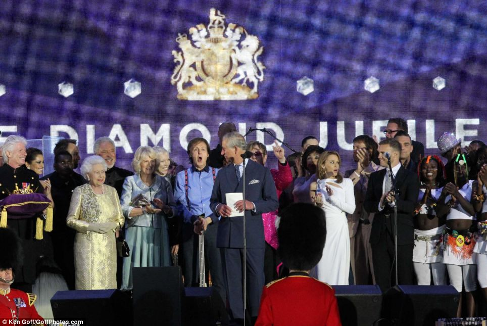 The artists gather around the Queen, the Duchess of Cornwall and the Prince of Wales, including Sir Paul McCartney, Kylie Minogue and Gary Barlow for Charles' speech