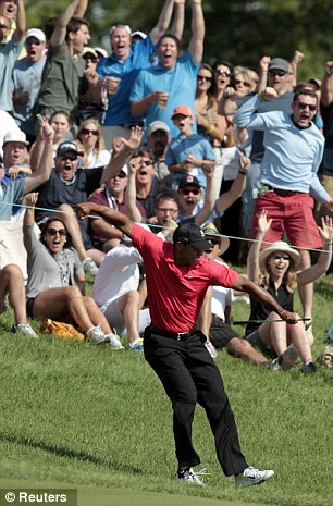Still got it: Woods reacts after chipping in for a birdie on the 16th hole during the Memorial Tournament