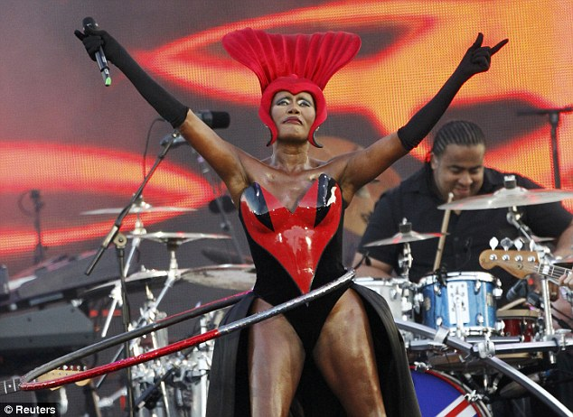 Living legend: Grace Jones surprised viewers with her revealing costume with featured a large red head dress and an open front dress