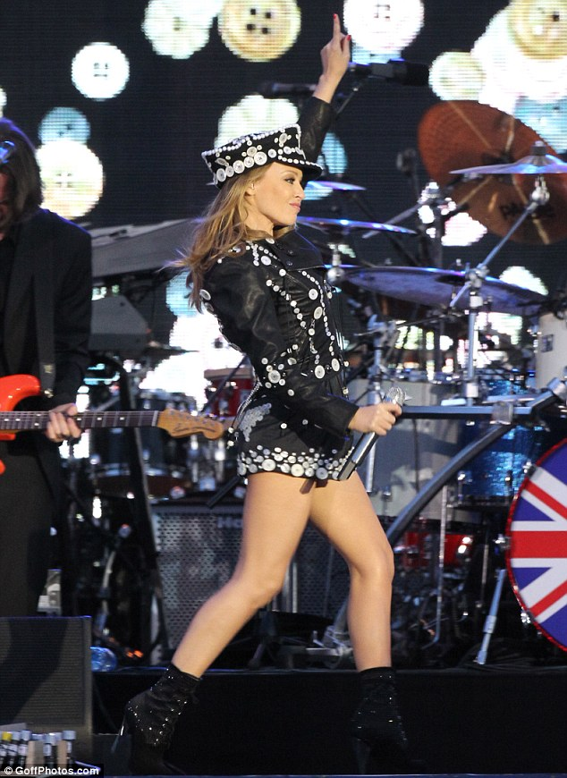 Put your hands up: Kylie entertained around 12,000 fans at  Buckingham Palace, The Mall, London