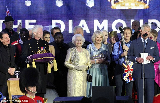 All together: The Queen took to the stage at the end of the concert with Prince Charles, Camilla and all of the acts from the night