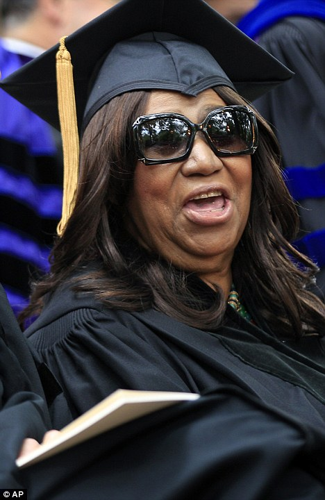 Very pleased: The new doctor looked like she was having a great time during the long-winded ceremony