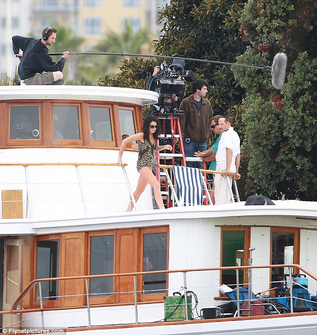 Lights, camera, action: Lindsay surrounded by the film crew on the boat