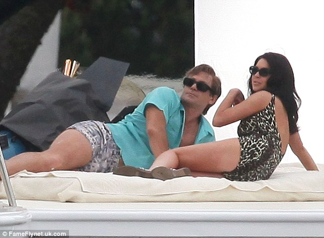 Familiar scene: Lindsay Lohan slipped into a swimsuit for her first day on set of Liz & Dick in Los Angeles today, seen with True Blood's Grant Bowler, who plays Richard Burton
