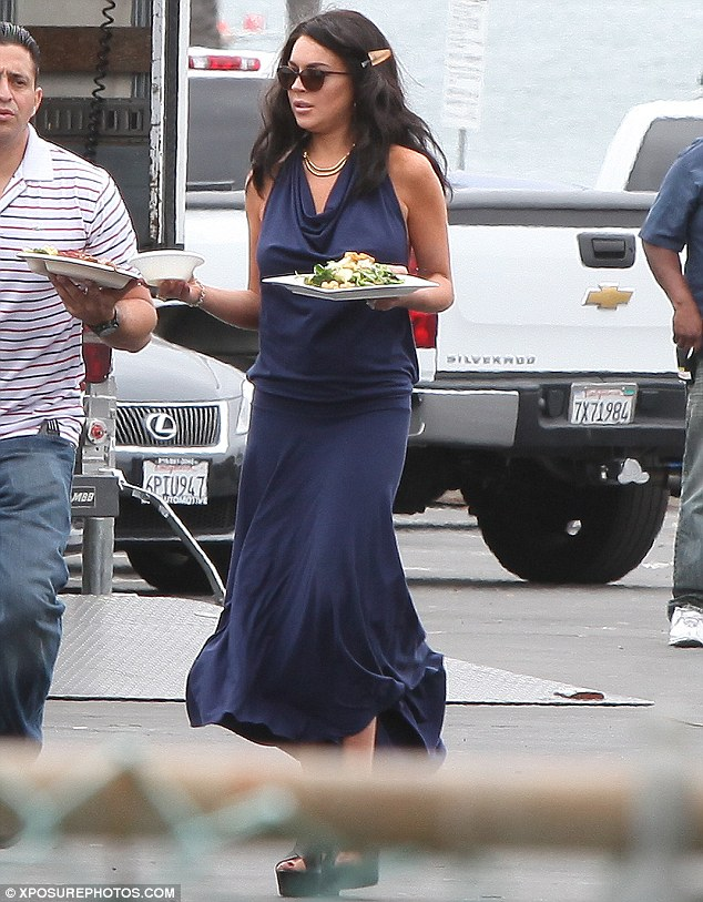 Lunch break: Lindsay changed into a blue dress during a break in filming to a grab a bite to eat