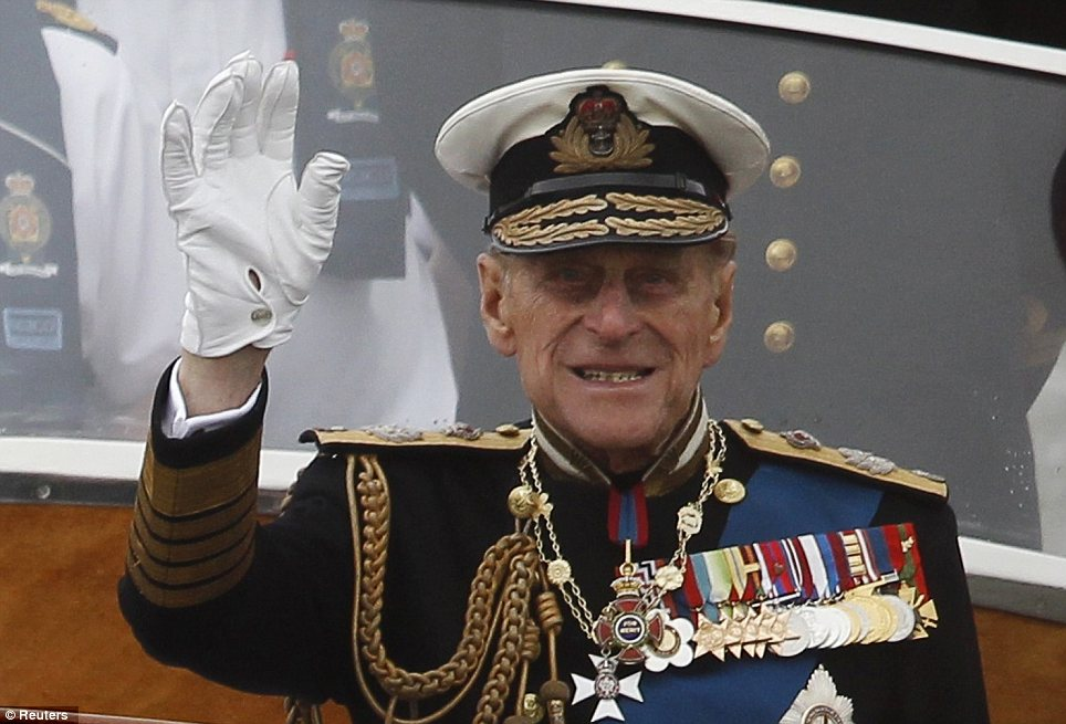 Unwell: Prince Philip waves from a boat during Sunday's pageant