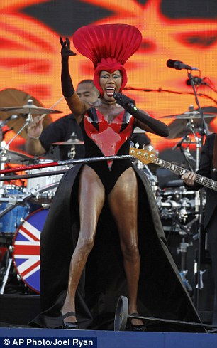 Putting Lady Gaga to shame: Grace wore a bizarre headdress and leotard to perform for the Queen