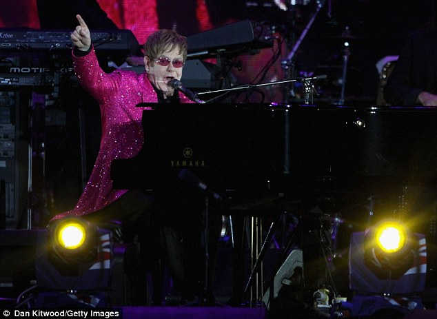 Can't beat a classic: Elton sits at his trusty piano as he serenades Queen Elizabeth