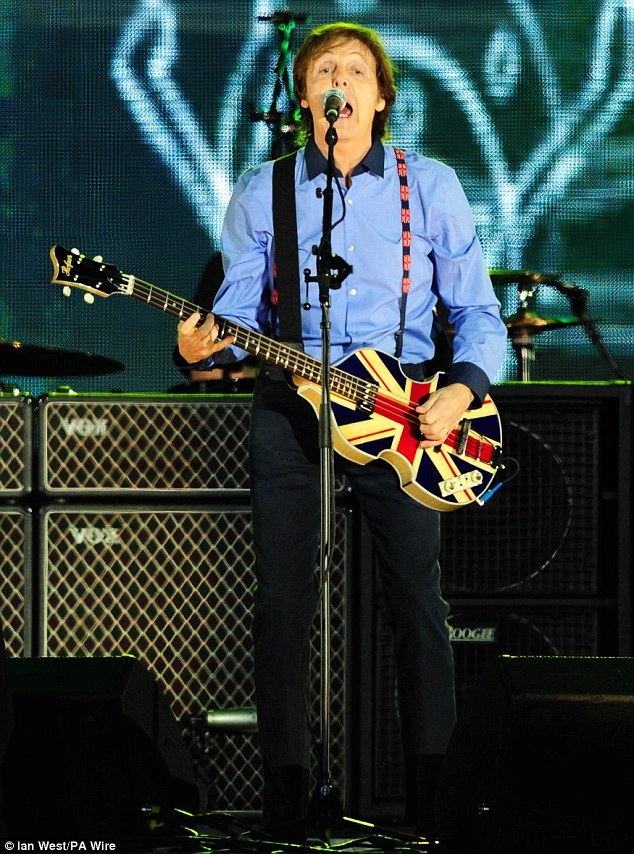 Continuing the union jack theme, the former Beatle then proceeded to play with a patriotic guitar