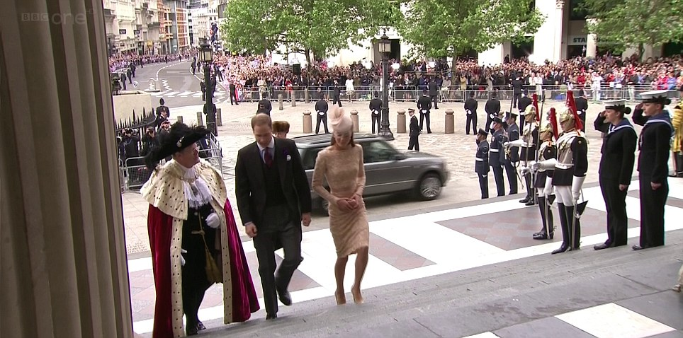 Beautiful in blush: The Duchess of Cambridge arrives with her husband the Duke