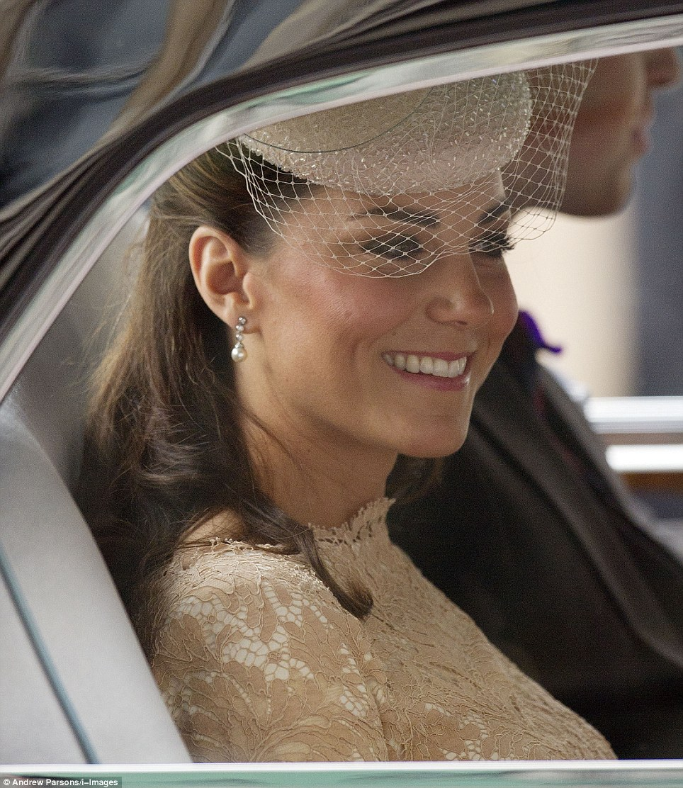 Chic: The Duchess wore pearls at her ears, subtle make up and pretty Alexander McQueen lace dress