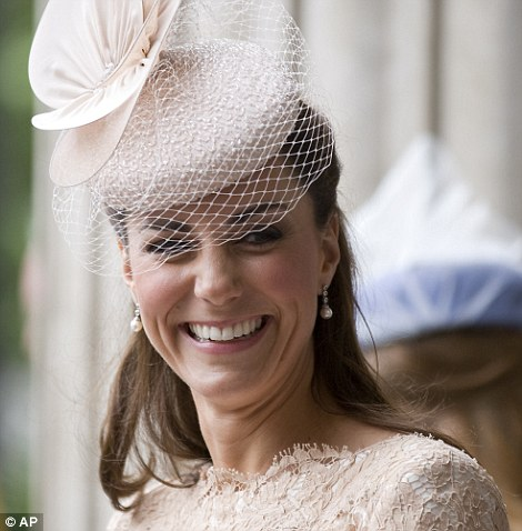 Stunning: The Duchess of Cambridge accessorised her Alexander McQueen dress with a net-trimmed hat by milliner Jane Taylor