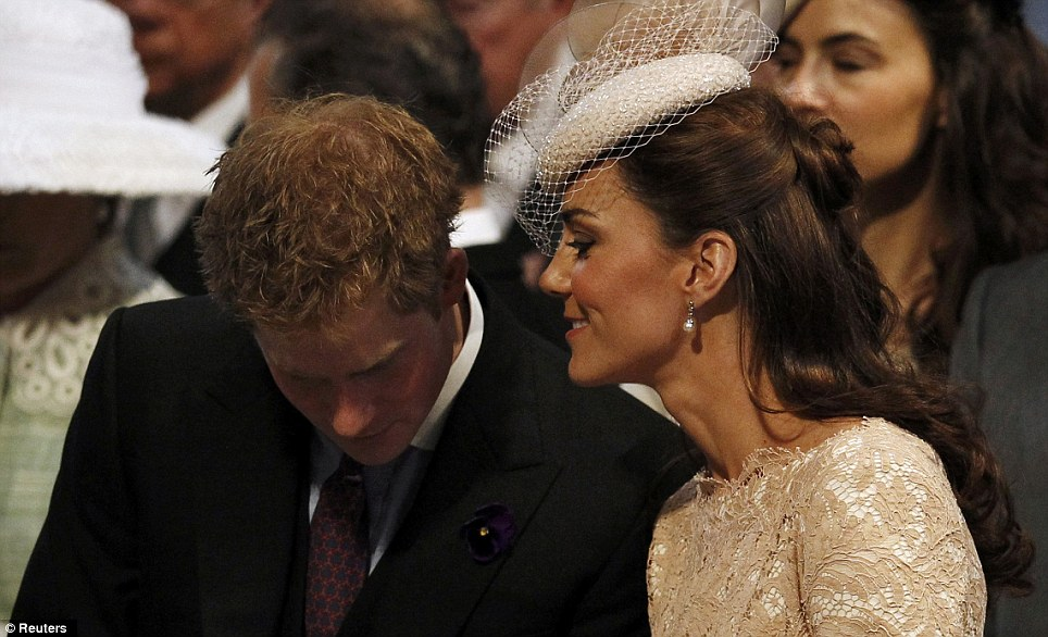 Close: Kate leans in to chat to Harry, who looked to be suffering slightly from the effects of a later night during the service