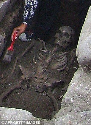 A close up of one of the 'vampire' skeletons discovered with a metal bar through its chest