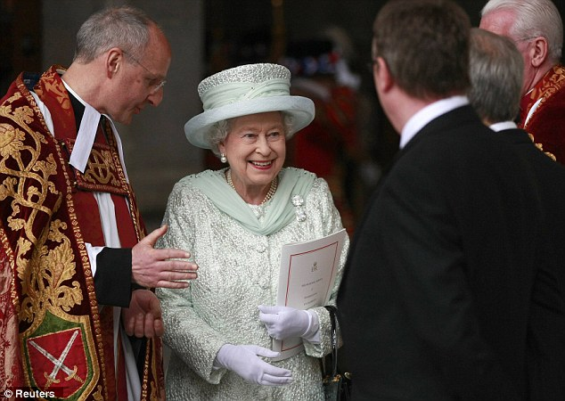 Having a jolly good time: Queen Elizabeth, with the Dean of St. Paul's David Ison, leaves after a service to celebrate her Diamond Jubilee at St Paul's Cathedral on Tuesday. The four-day event concludes today