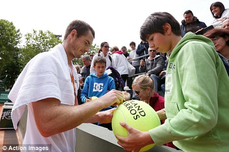 On the ball: Murray, who signed autographs for fans during his Tuesday practice session, is determined to reach the semi-finals
