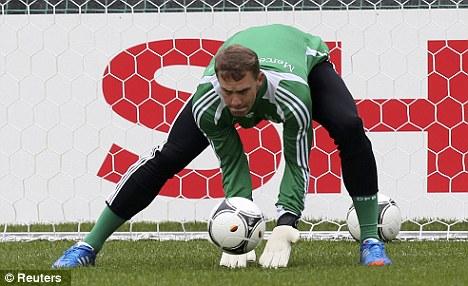 Safe hands: Bayern Munich goalkeeper Manuel Neuer warms up for Euro 2012