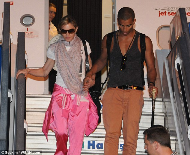 I wanna hold your hand! Mandonna touches down in Istanbul and holds hands with Brahim Zaibat as she leaves the plane