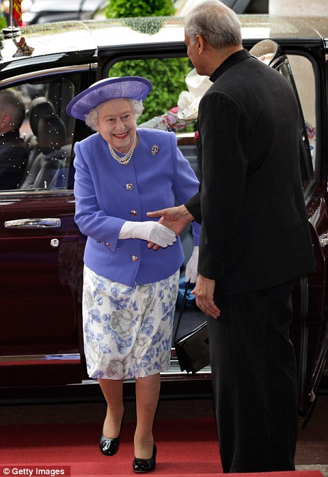 The Queen is greeted by the Commonwealth Secretary-General Kamalesh Sharma as she attends a lunch with Commonwealth Nations Heads  of Government and representatives of the Commonwealth nations, in central London